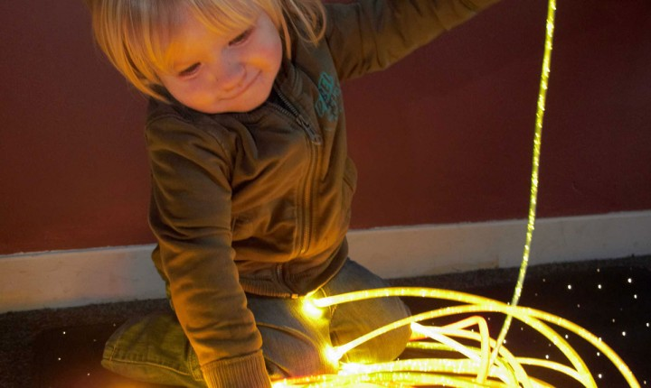 Child playing with sensory lighting kit